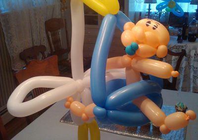 balloon stork and baby